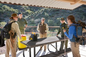 Tonto National Monument staff conduct a safety brief before heading to the Upper Cliff Dwelling March 12 during Tonto's Heritage Days. The Monument had more than 600 visitors on the first day of the weekend-long event, which is a significant increase from normal weekend visitation.