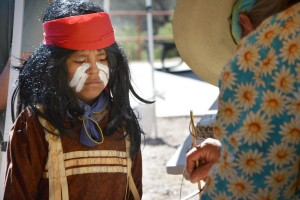 – A young performer with the Kennedy Johnson San Carlos Group watches an ancient technology demonstration, March 12, during Tonto National Monument's Heritage Days. The San Carlos Group performed four times March 12 and 13.